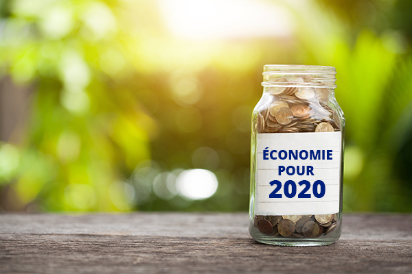 Plan For 2020 Word With Coin In Glass Jar.